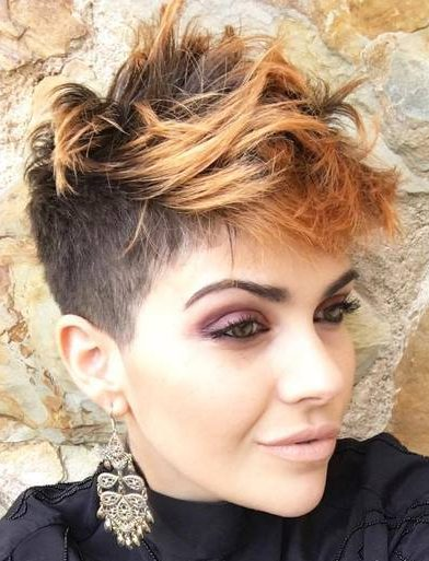 short choppy hairstyle with light copper balayage